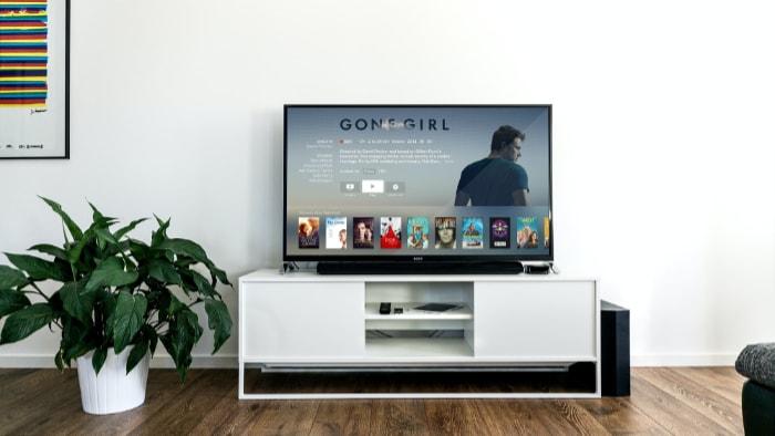 Black TV on white table
