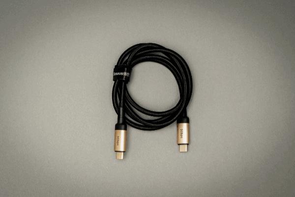 Black USB C on white surface