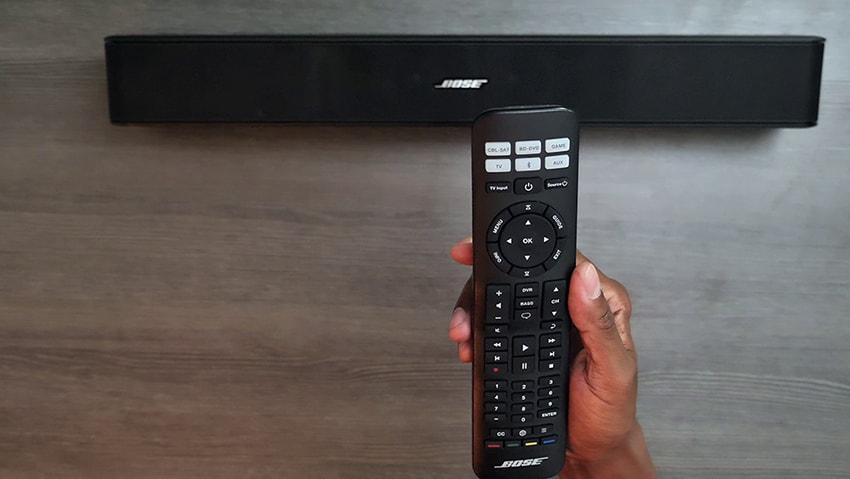 Black Bose Solo 5 TV remote on hand