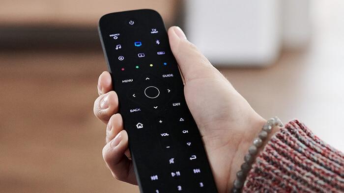 Black Bose Soundbar 700 remote on hand