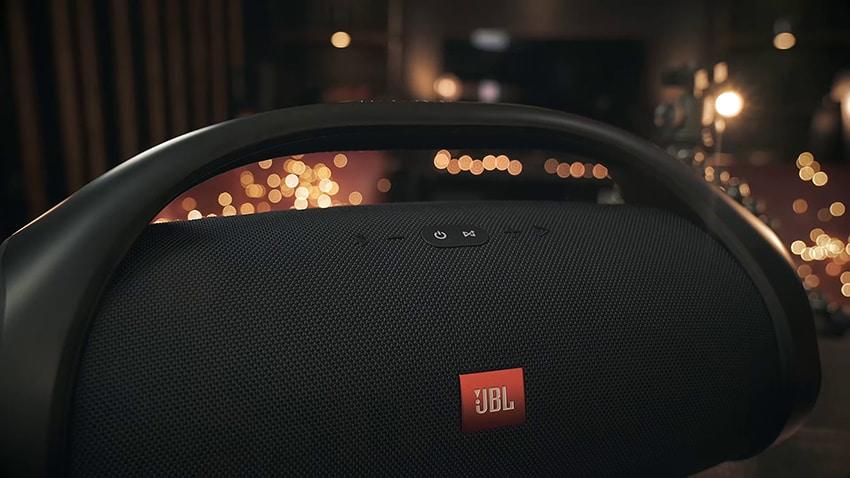 Black JBL Boombox button on black table