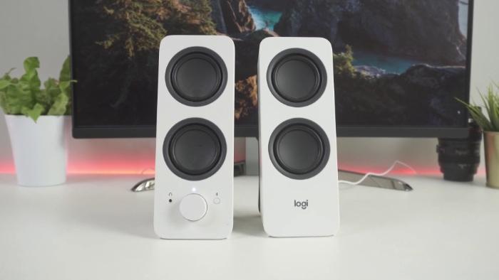 White Logitech Z207 on white desk