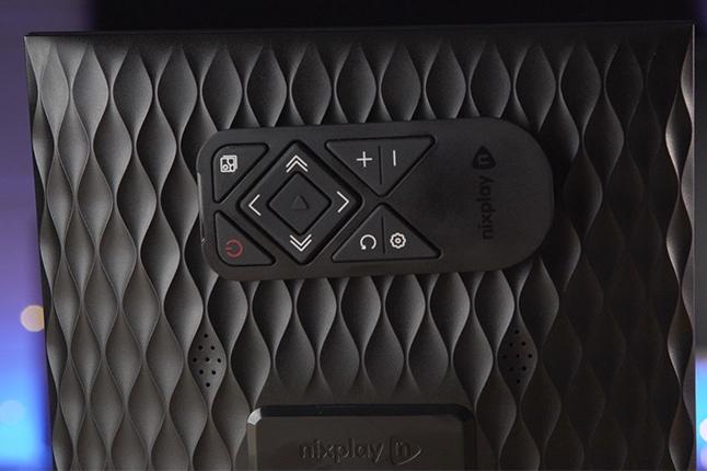Black remote on Nixplay Smart Digital Picture Frame