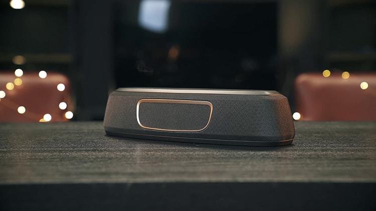 Black Polk Audio MagniFi Mini on black table