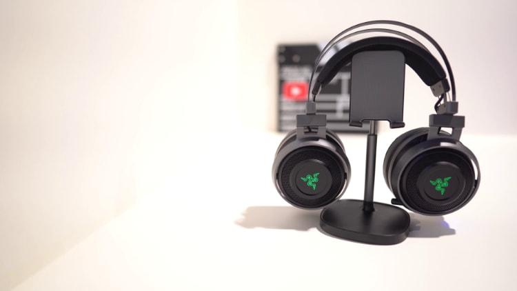 Black Razer Nari Ultimate on phone stand