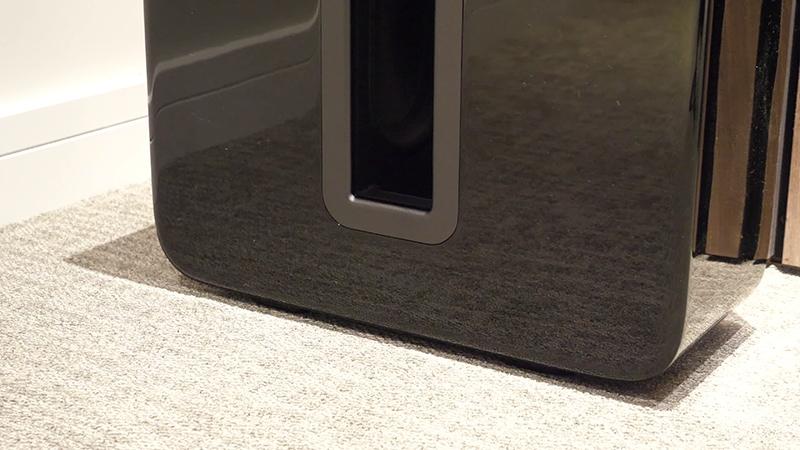 Black Sonos Sub Gen 3 close-up on cream carpet