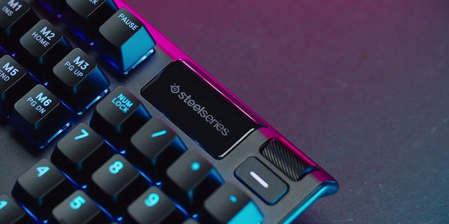 Black SteelSeries Apex Pro with LED screen turned on