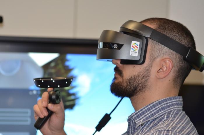 Man playing HP virtual reality